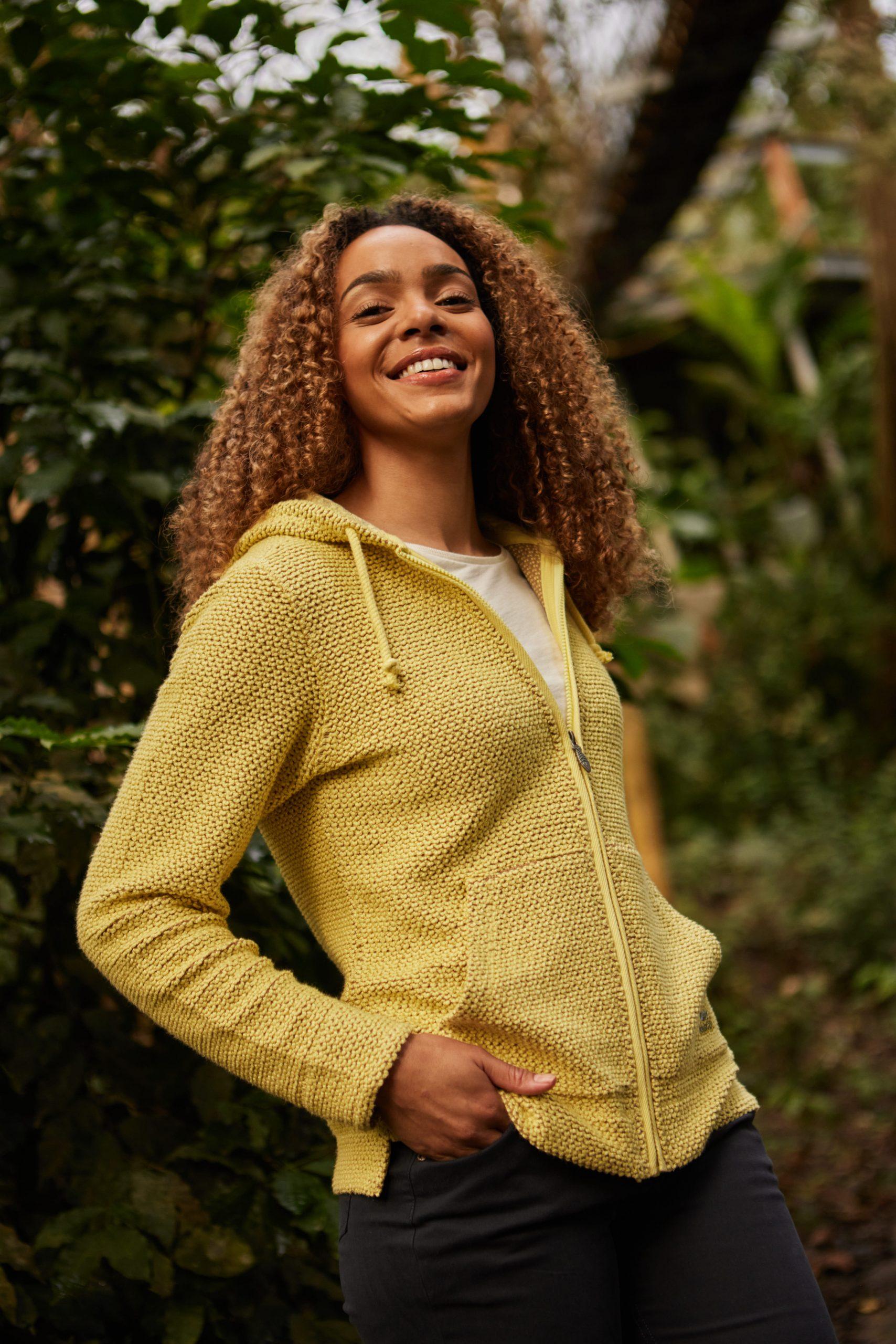 Women outdoors wearing a yellow jacket