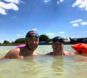 Man and Women Swimming