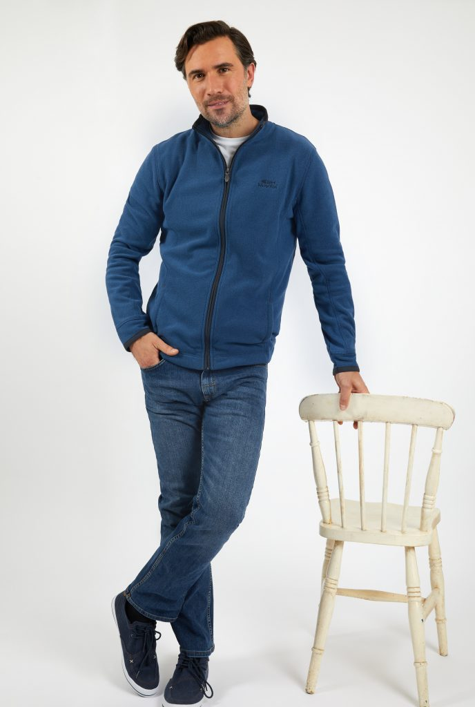 Man in fleece hoodie and jeans